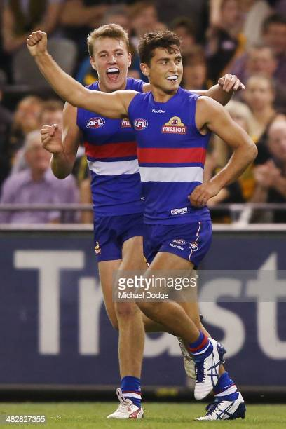 Luke Dahlhaus of the Bulldogs celebrates a goal with Lachie Hunter during the round three AFL match between the Western Bulldogs and the Richmond...