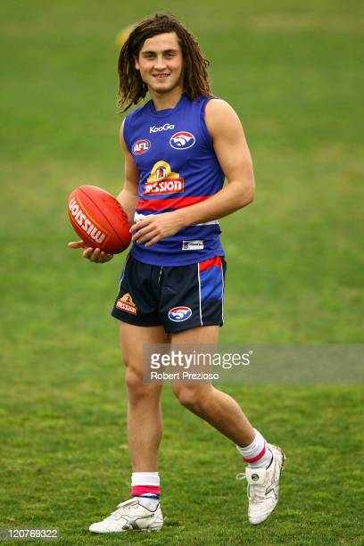 Luke Dahlhaus of the Bulldogs holds the ball during a Western Bulldogs AFL training session at Whitten Oval on August 10 2011 in Melbourne Australia