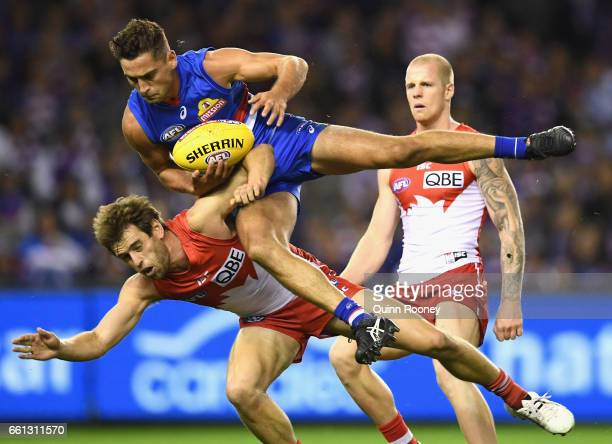 Luke Dahlhaus of the Bulldogs marks over the top of Jake Lloyd of the Swans during the round two AFL match between the Western Bulldogs and the...