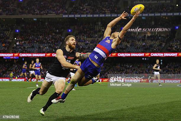 Luke Dahlhaus of the Bulldogs marks the ball against Zach Tuohy of the Blues during the round 14 AFL match between the Western Bulldogs and the...