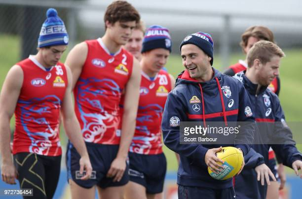 Luke Dahlhaus of the Bulldogs runs with the ball during a Western Bulldogs AFL training session at Whitten Oval on June 13 2018 in Melbourne Australia