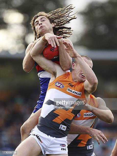 Luke Dahlhaus of the Bulldogs takes a mark over Tom Scully of the Giants during the round 15 AFL match between the Greater Western Sydney Giants and...