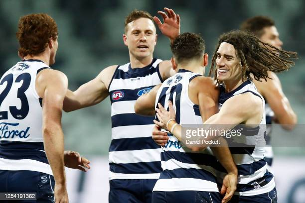 Luke Dahlhaus of the Cats celebrates a goal during the round 5 AFL match between the Geelong Cats and the Gold Coast Suns at GMHBA Stadium on July...