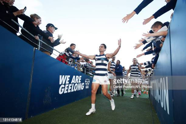 Luke Dahlhaus of the Cats celebrates with fans after the round six AFL match between the Geelong Cats and the West Coast Eagles at GMHBA Stadium on...
