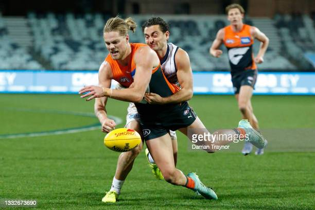 Luke Dahlhaus of the Cats tackles Harry Himmelberg of the Giants during the round 21 AFL match between Geelong Cats and Greater Western Sydney Giants...
