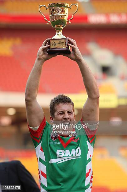 Luke Dalziel-Don of the Seagulls holds up the winners trophy after the QLD Cup Grand Final between the Tweed Heads Seagulls and the Wynnum Manly...