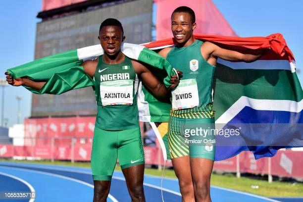 Luke Davids of South Africa poses with Olukunle Alaba Akintola of Nigeria after the Men's 100m Stage 2 heat 5 during day 9 of the Buenos Aires Youth...