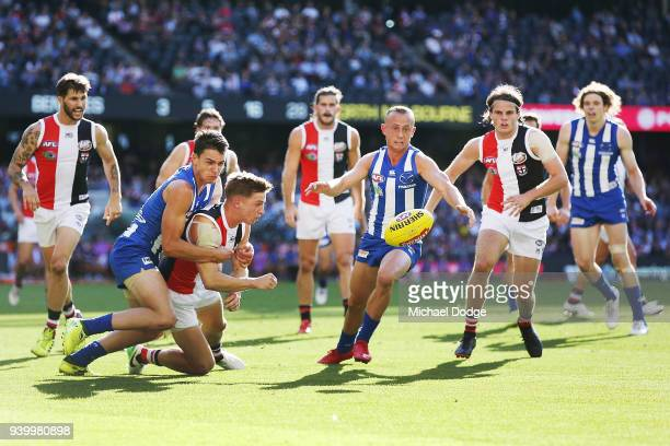 Luke DaviesUniack of the Kangaroos and Billy Hartung of the Kangaroos tackle Jack Billings of the Saints during the round two AFL match between the...