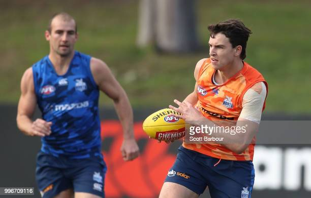 Luke DaviesUniacke and Ben Cunnington of the Kangaroos compete for the ball during a North Melbourne Kangaroos Training Session on July 12 2018 in...