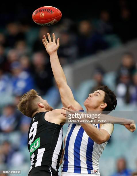 Luke DaviesUniacke of the Kangaroos and Sam Murray of the Magpies compete for the ball during the 2018 AFL round 18 match between the Collingwood...