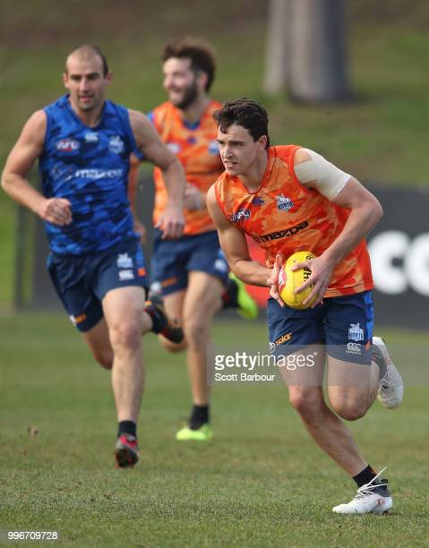 Luke DaviesUniacke of the Kangaroos runs with the ball during a North Melbourne Kangaroos Training Session on July 12 2018 in Melbourne Australia