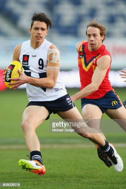 Luke DAVIESUNIACKE of Vic Country runs with the ball during the U18 AFL Championships match between Vic Country and South Australia at Simonds...