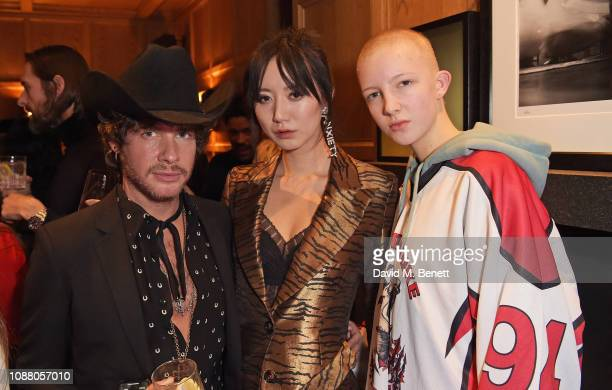 Luke Day Betty Bachz and Finn Buchanan attend Burns Night Gathering hosted by Christopher Kane and The London EDITION on January 24 2019 in London...