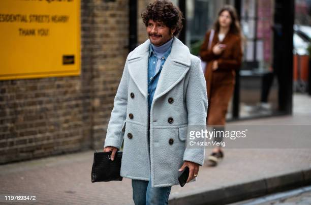 Luke Day is seen wearing double breated coat during London Fashion Week Men's January 2020 on January 05 2020 in London England