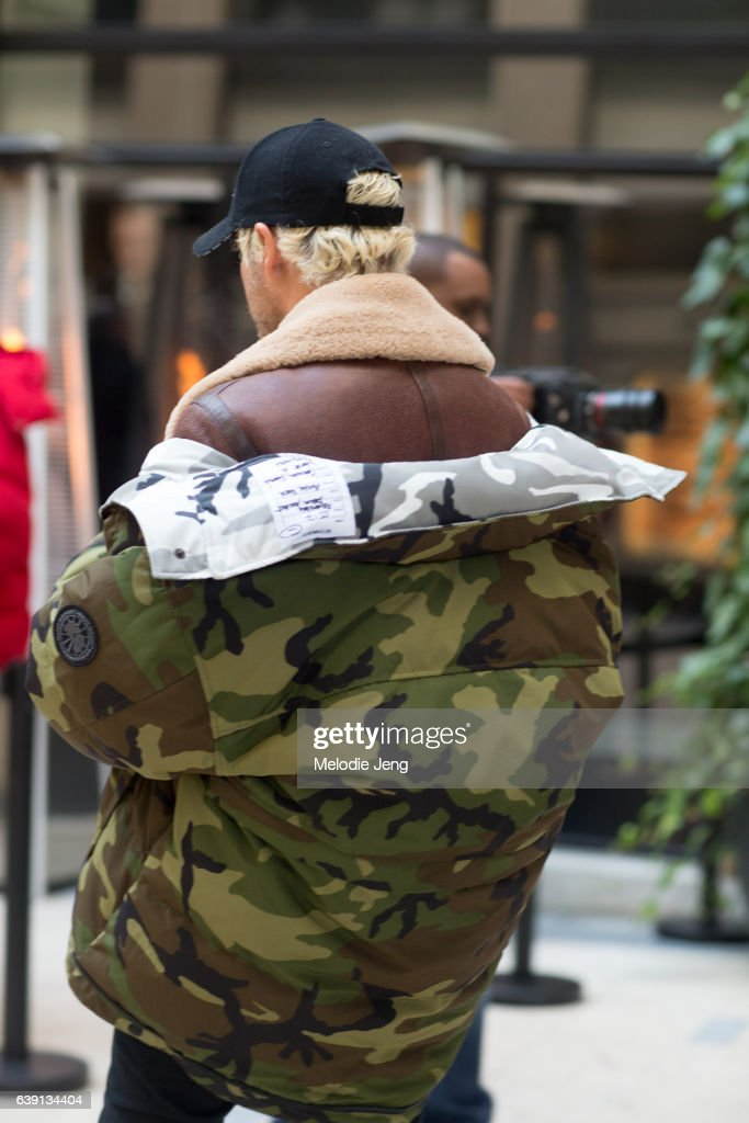055ae7cc46a4d Street Style   Paris Fashion Week - Menswear Fall Winter 2017 2018   Day  One. Luke Day wears a red Vetements x Canada Goose ...