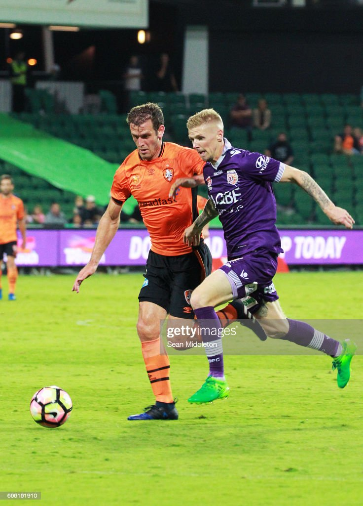 Luke De Vere #3 of the Roar and Andrew Keogh #9 of the Glory during the round 26 A-League match between the Perth Glory and Brisbane Roar at nib Stadium on April 8, 2017 in Perth, Australia.