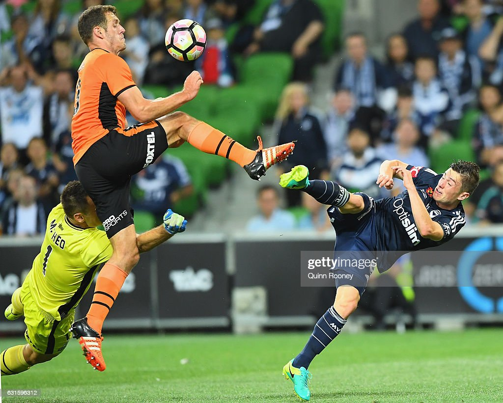 Luke De Vere of the Roar and Marco Rojas of the Victory compete for the ball during the round 15 A-League match between the Melbourne Victory and the Brisbane Roar at AAMI Park on January 13, 2017 in Melbourne, Australia.