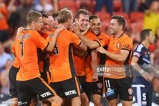 Luke De Vere of the Roar celebrates with team mates after scoring a goal during the round one ALeague match between the Brisbane Roar and Melbourne...