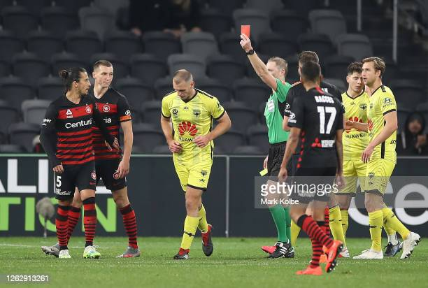 Luke De Vere of the Wellington Phoenix is shown the red card by referee Kurt Ams during the round 29 A-League match between the Western Sydney...