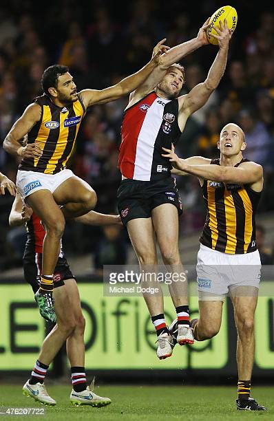 Luke Delaney of the Saints marks the ball against Cyril Rioli and David Hale of the Hawks during the round 10 AFL match between the St Kilda Saints...