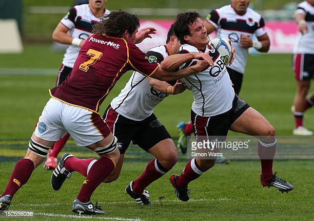 Luke Devcich of North Harbour is tackled during the round nine ITM Cup match between North Harbour and Southland at North Harbour Stadium on...