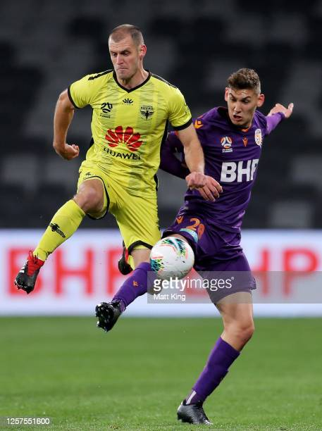 Luke DeVere of the Phoenix competes for the ball against Gabriel Popovic of the Glory during the round 27 A-League match between the Perth Glory and...