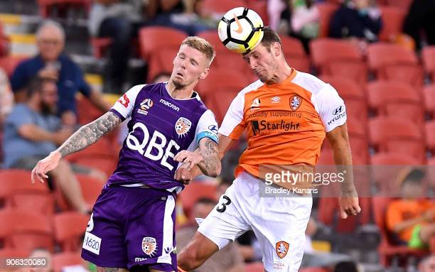 Luke DeVere of the Roar and Andrew Keogh of the Glory challenge for the ball during the round 17 ALeague match between the Brisbane Roar and the...