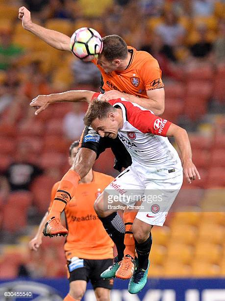 Luke DeVere of the Roar and Brendan Santalab of the Wanderers challenge for the ball during the round 22 ALeague match between Brisbane Roar and...