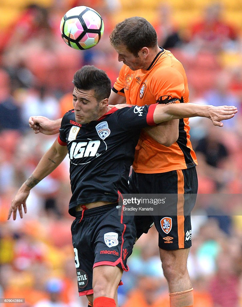 Luke DeVere of the Roar and Sergio Guardiola of Adelaide challenge for the ball during the round 10 A-League match between the Brisbane Roar and Adelaide United at Suncorp Stadium on December 11, 2016 in Brisbane, Australia.