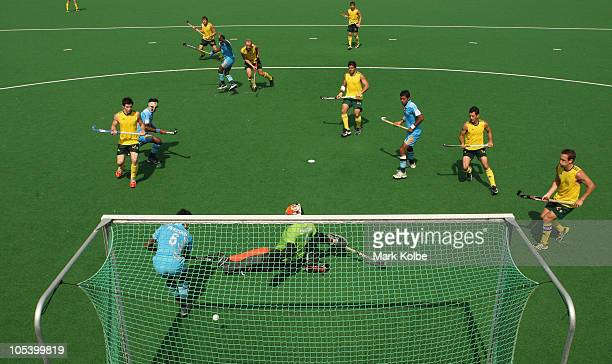 Luke Doerner of Australia scores a goal during the Men's Gold medal match between Australia and India at the Major Dhyan Chand National Stadium...