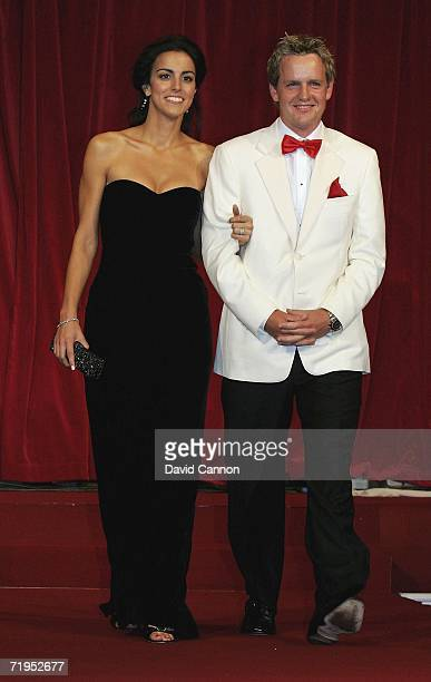 Luke Donald and Girlfriend Diane Antonopoulos walk down the catwalk during the Ryder Cup Gala Dinner at Citywest Hotel and Golf Resort September 20...