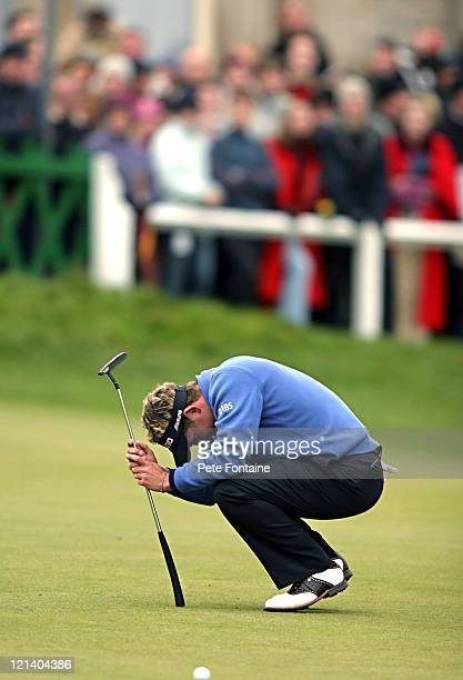 Luke Donald misses a birdie putt on the eighteenth green to go into a playoff during the final round of the Dunhill Links Championship held at the...