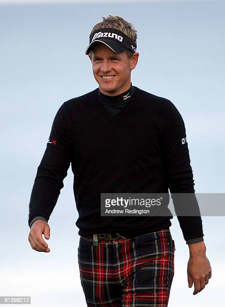 Luke Donald of England acknowledges the crowd after finishing his round on the 18th green during the third round of The Alfred Dunhill Links...