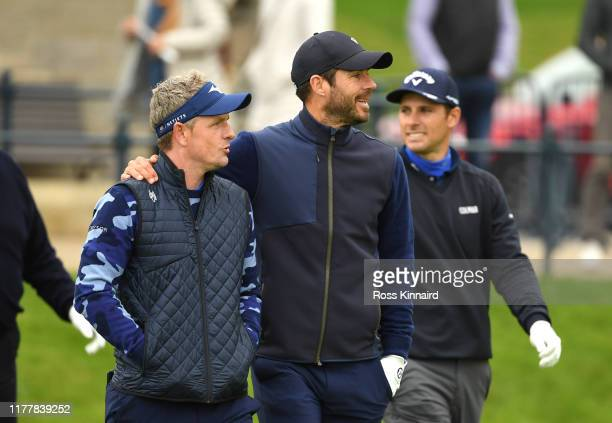 Luke Donald of England and former football player Jamie Redknapp on the first hole during Day four of the Alfred Dunhill Links Championship at The...
