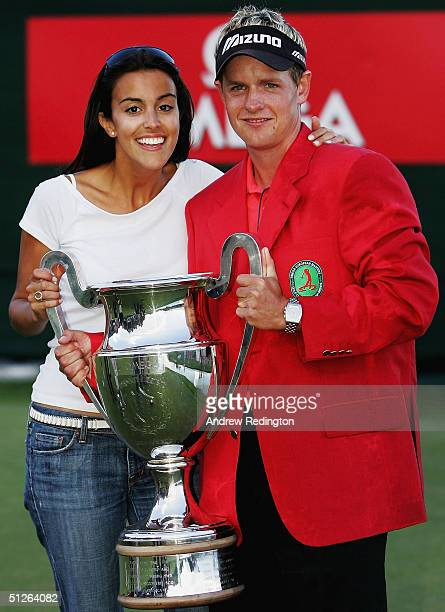 Luke Donald of England and his girlfriend Diane Antonopoulos pose with the trophy after winning The Omega European Masters at CransSurSierre Golf...
