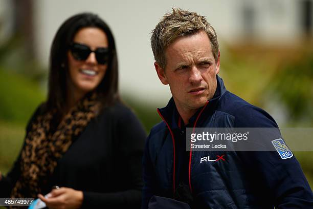 Luke Donald of England and his wife Diane look on from the putting green during the final round of the RBC Heritage at Harbour Town Golf Links on...