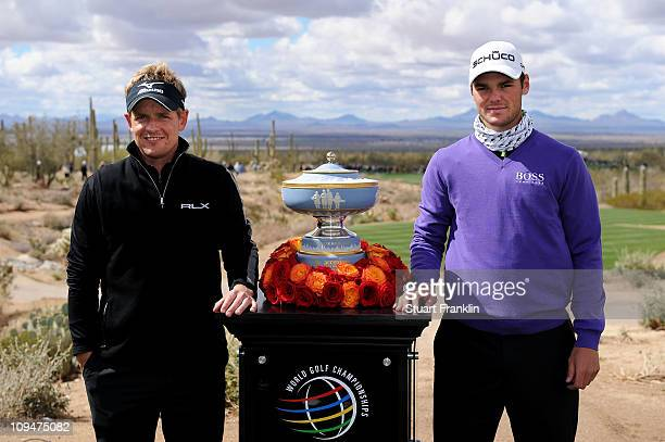Luke Donald of England and Martin Kaymer of Germany smile next to The Walter Hagen Cup trophy on the first hole before playing the final round of the...