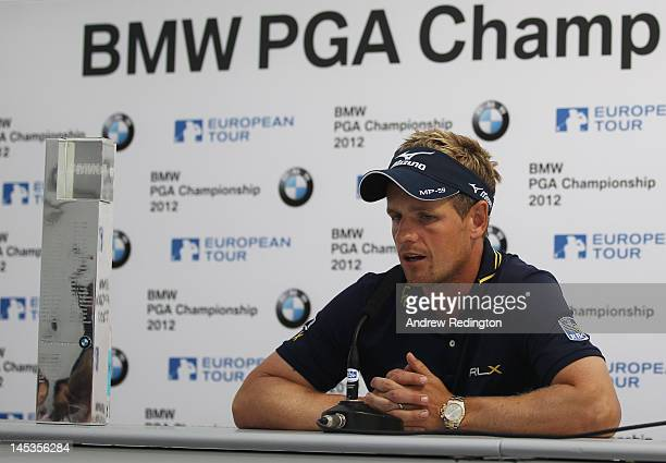 Luke Donald of England answers questions at a press conference following his victory during the final round of the BMW PGA Championship on the West...