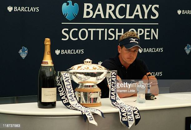 Luke Donald of England answers questions from the press following his victory at the end of the final round of The Barclays Scottish Open at Castle...