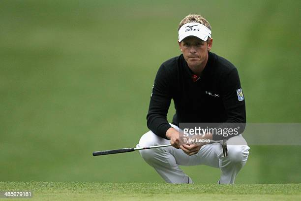 Luke Donald of England assesses a putt on the 15th green during the third round of the RBC Heritage at Harbour Town Golf Links on April 19 2014 in...