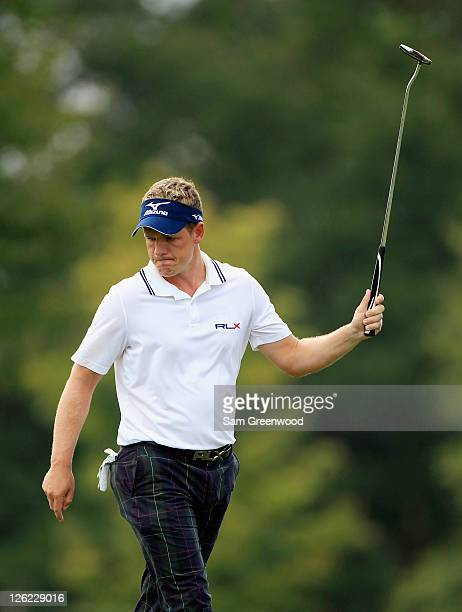 Luke Donald of England celebrates a birdie on the seventh hole during the second round of the TOUR Championship at East Lake Golf Club on September...