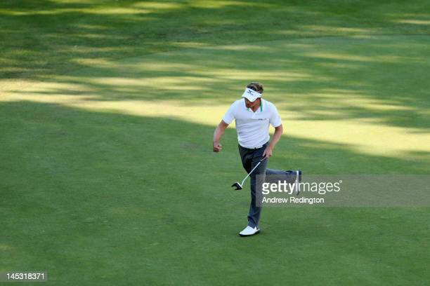 Luke Donald of England celebrates a birdie putt on the 18th hole during the third round of the BMW PGA Championship on the West Course at Wentworth...