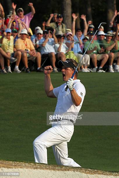 Luke Donald of England celebrates after holing a pitch shot for birdie on the 18th hole during the final round of the 2011 Masters Tournament at...