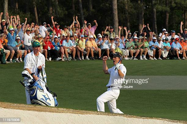 Luke Donald of England celebrates chipping in on the 18th hole during the final round of the 2011 Masters Tournament at Augusta National Golf Club on...