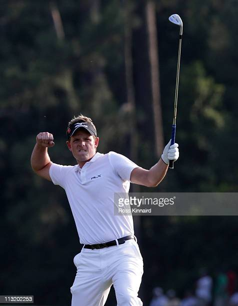 Luke Donald of England celebrates his birdie on the 18th hole during the final round of the 2011 Masters Tournament at Augusta National Golf Club on...