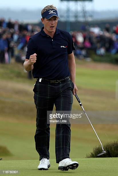 Luke Donald of England celebrates holing a putt on the 16th green during the final round of The Barclays Scottish Open at Castle Stuart Golf Links on...