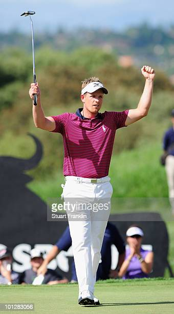Luke Donald of England celebrates holing the winning putt on the 18th hole during the final round of the Madrid Masters at Real Sociedad Hipica...