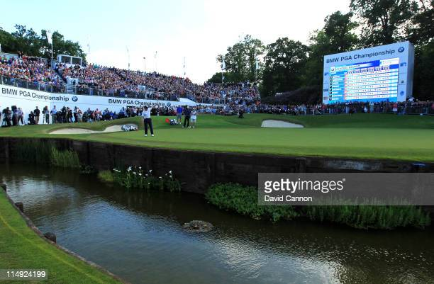 Luke Donald of England celebrates victory in a playoff on the 18th green during the final round of the BMW PGA Championship at the Wentworth Club on...