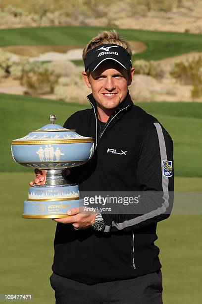 Luke Donald of England celebrates with The Walter Hagen Cup trophy after winning his match 3-up on the 16th hole during the final round of the...