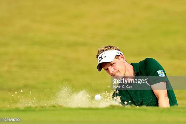 Luke Donald of England chips out of the sand onto the 14th green during the second round of THE TOUR Championship presented by CocaCola at East Lake...